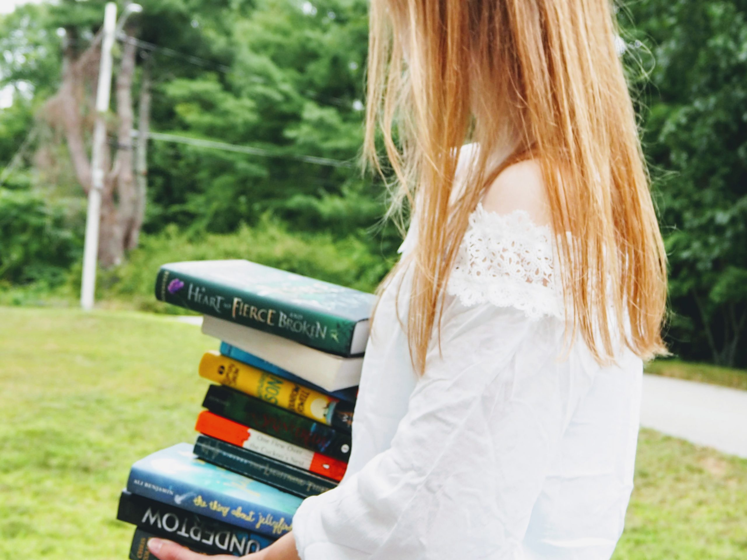 Holding a pile of books